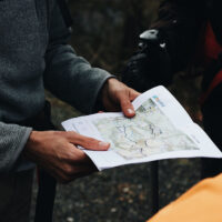trekking_0000_person-looking-at-a-map-3604968